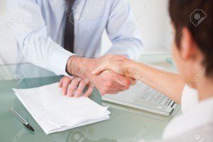 11187522-office-workers-having-a-handshake-in-an-office-lawyer-client-handshake